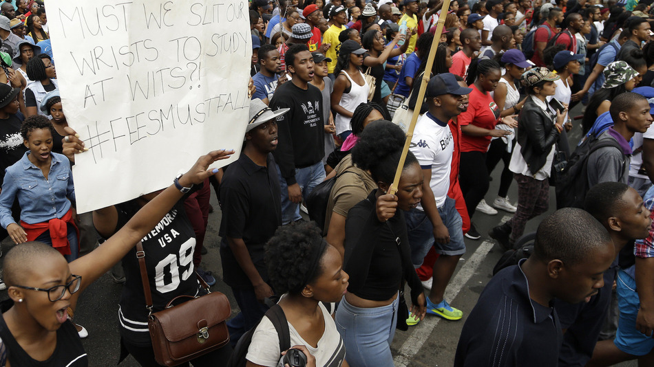 University of the Witwatersrand students march during their protest in Johannesburg, South Africa, Wednesday, Oct. 21, 2015. The protests are part of a wave of nationwide protests that have shut down many South Africa universities, which say they are struggling with higher operational costs as well as inadequate state subsidies. (AP Photo/Themba Hadebe)